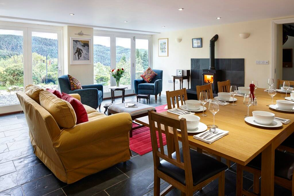The dining room, seating for 12.  Ideal for bird watching. Wood burner, views across the valley.