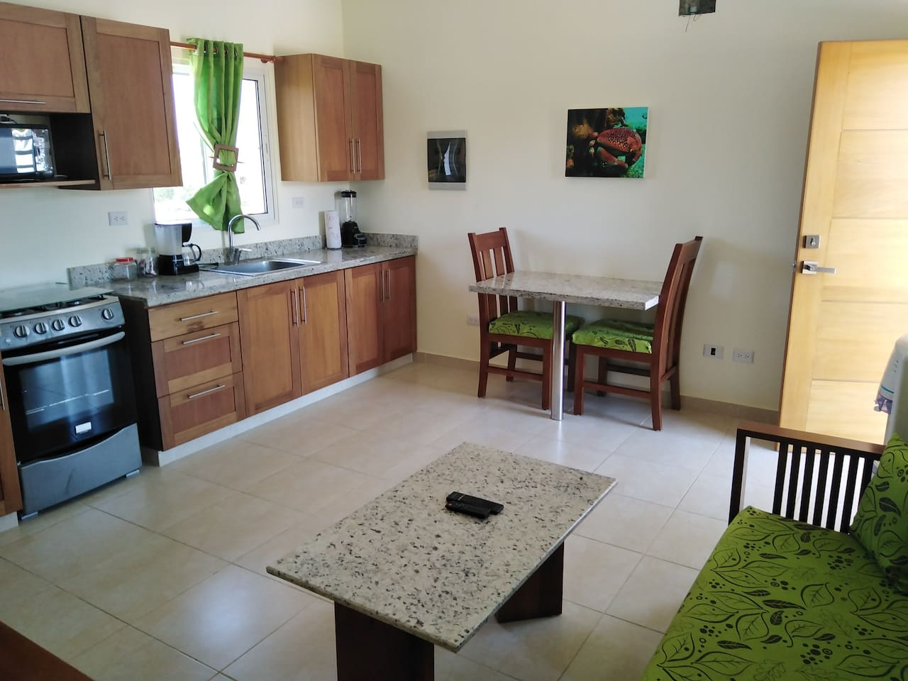 Welcome to Casa De Compai. This one bedroom has a full kitchen with tv, sofa and dining table. All the condos at Casa De Compai have mahogany and granite furniture.