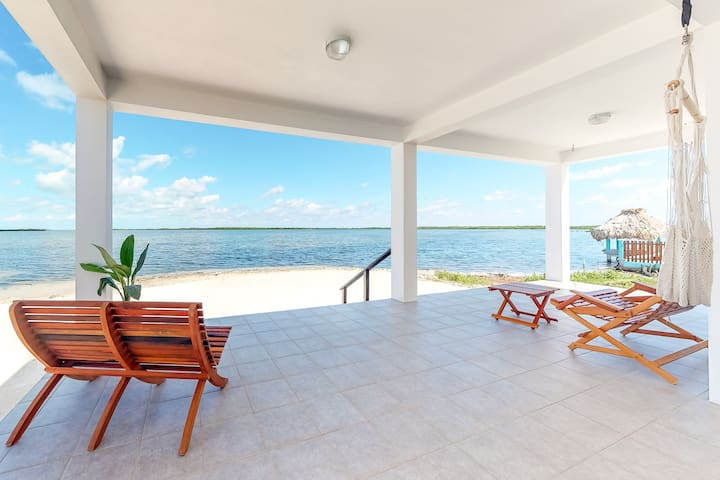 Waterfront home with private lanai & hammock in quiet area and w/ great views!