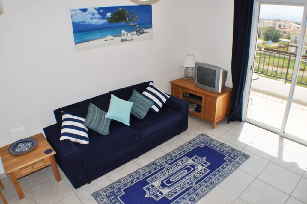 Comfortable living area with TV, DVD and sea views