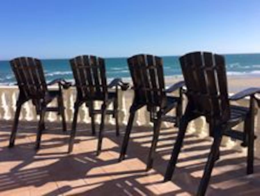 Expansive roof top space overlooking Sandy Beach.  Comfortable new chairs tall enough to have no obstruction of this beautiful beachfront view.