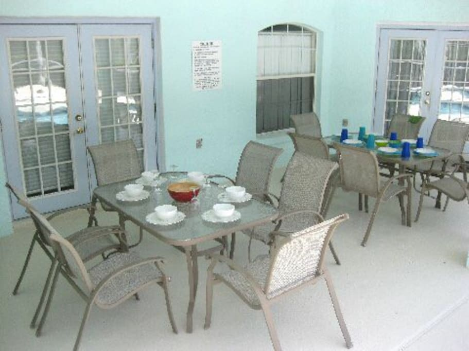 Spacious lanai ( An area under the roof - so stays  dry and provides much needed shade in the summer period) Ample outdoor dining space- - two tables to seat 12 people - home has high chair - pack and play- strollers - crib.