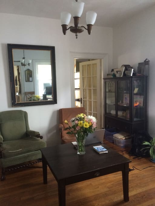 This is the living room on the first floor. Large room right off the kitchen with comfortable seating and loaded cable tv package