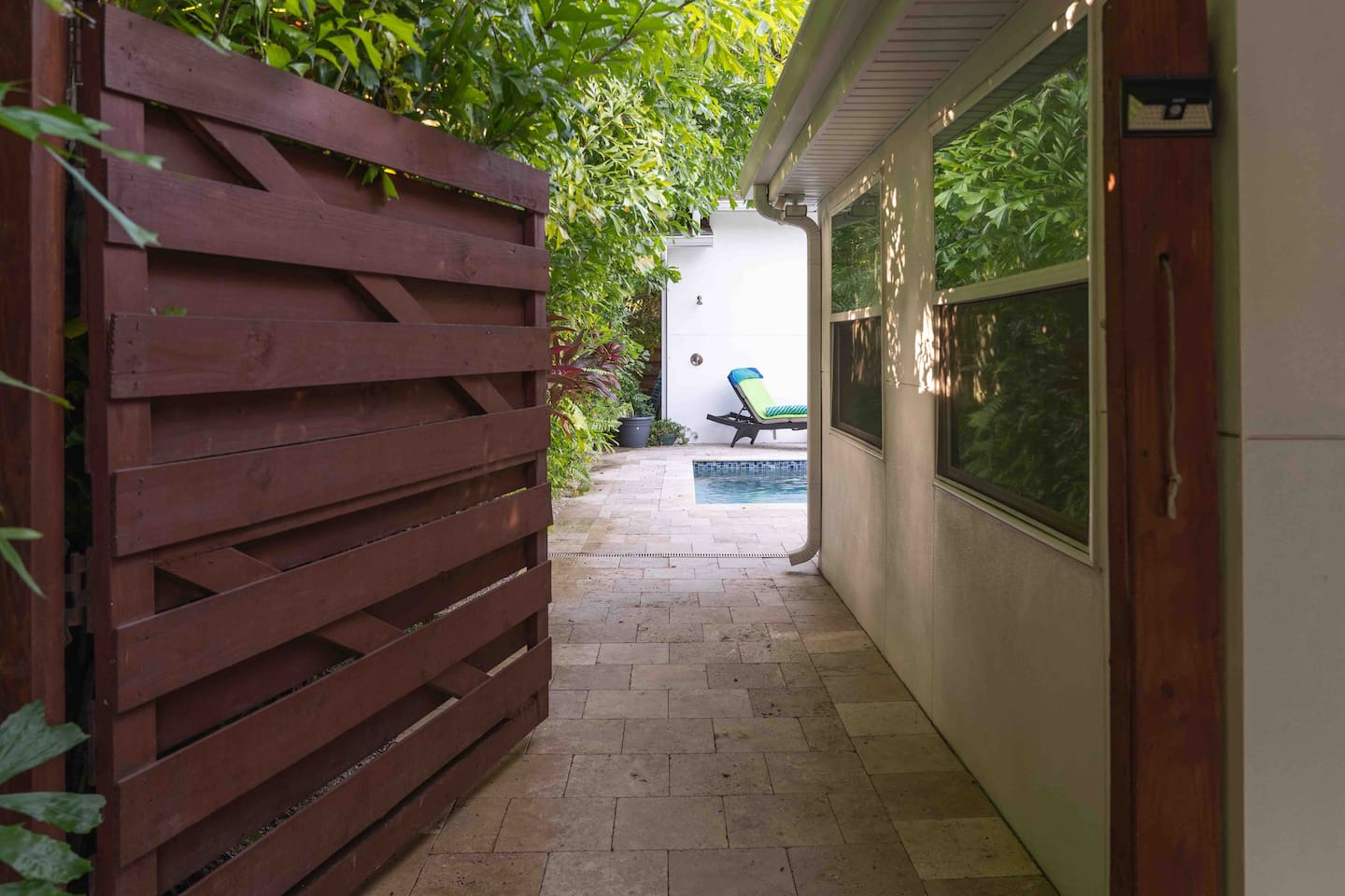 Gateway and walkway to Bungalow, Patio and Pool area.