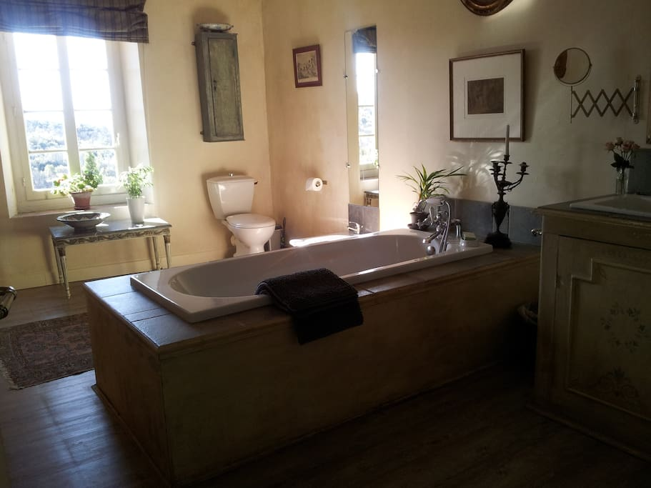 Large ensuite bathroom with view of the Pyrenees.