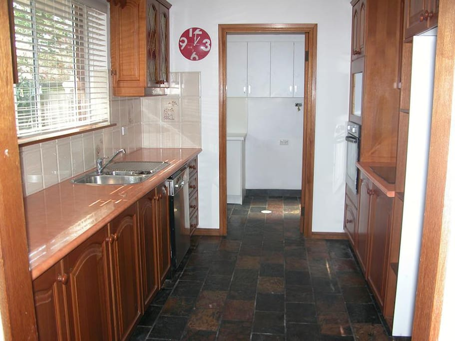 Shared galley kitchen, with access to courtyard, laundry and toilet.