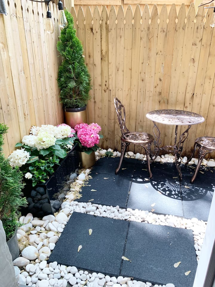 Beautiful Garden area with bistro table and chairs & a love seat for lounging in the evenings.