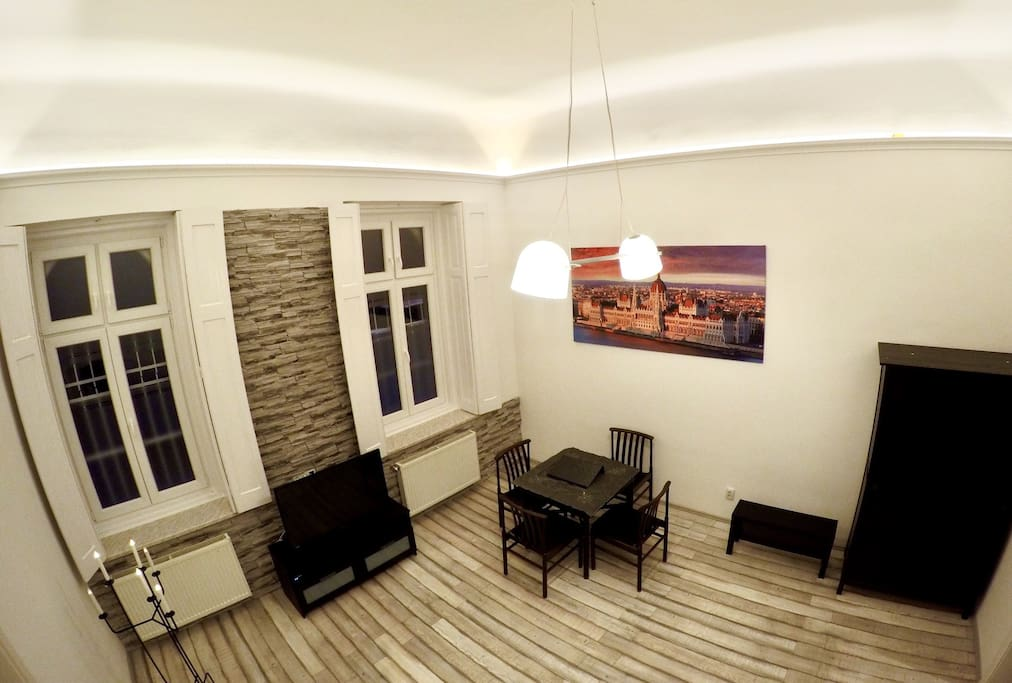 Modern flat in the old house: 5m inner height, with warm LED light.