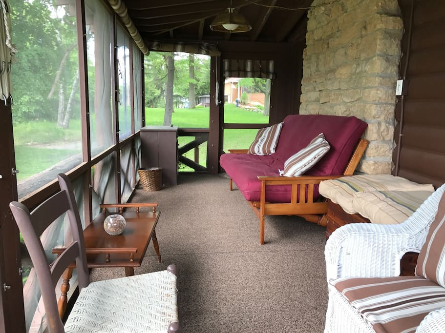 Wrap-around porch with futon and privacy shades