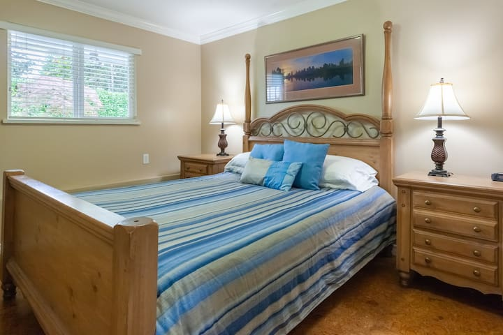 The master bedroom has a queen bed, and overlooks the pool and backyard area.