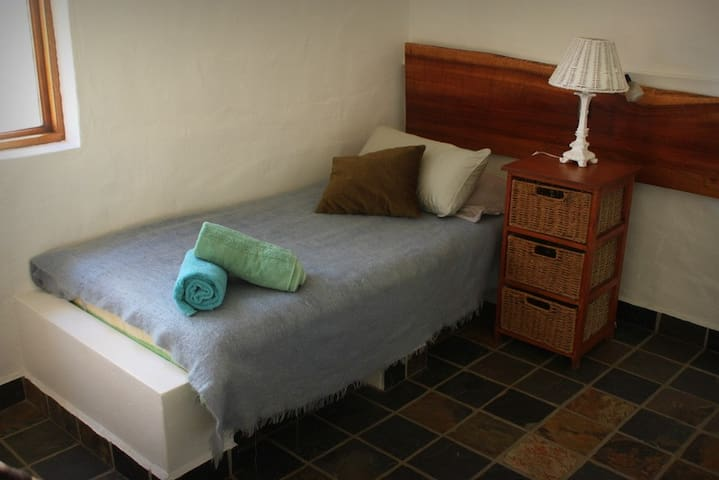 The second bedroom have two comfortable single beds and drawer cabinets for clothing.