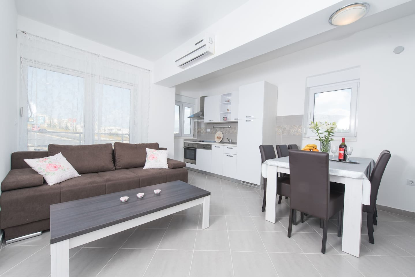 Kitchen with dining area and living room