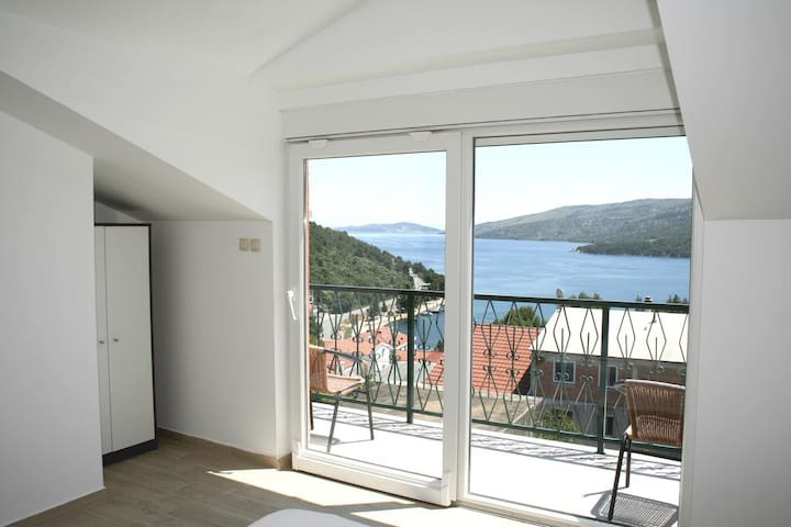 Two bedroom apartment with balcony and sea view Marina (Trogir) (A-11607-a)