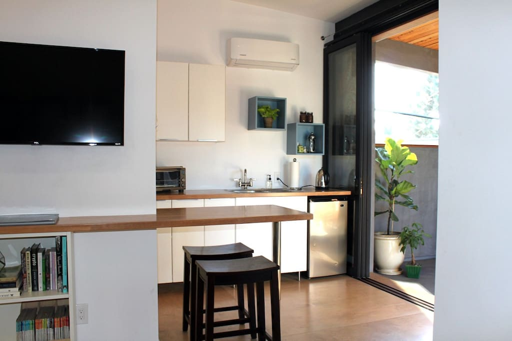 Eat in kitchenette with toaster oven, microwave, convection cooktop, electric kettle, french press and mini fridge.