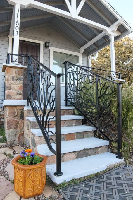 Local ironworks artist created railings.