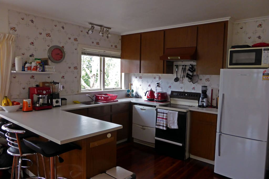 Kitchen photo, open, spacious, dishwasher, coffee machine with bean grinder for fresh coffee. Bar stools to sit at the bench, or relax while watching someone else cook. Brand new fridge for fresh groceries and ample space in the pantry for other.