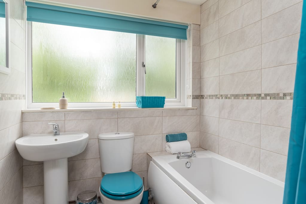 Bathroom with bath and electric shower