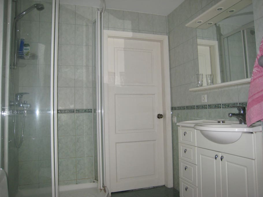 Bathroom for common use, hairdryer, washing machine