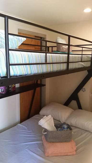 You will be on the top of a bunk bed (keep in mind the narrow space)