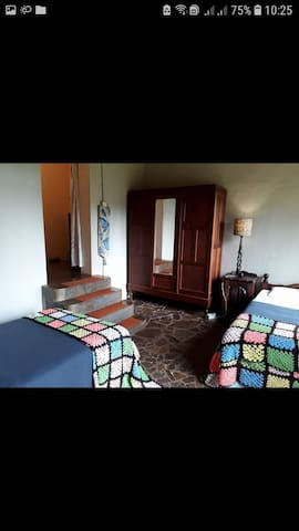 Bedroom with 2 single beds for the kids which is the passage to the second double bedroom