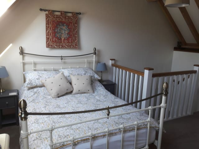 Comfortable upstairs bedroom with double bed.