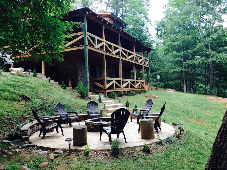 Aska Escape is a three level solid wood cabin with wrap-around porches, outdoor fire pit and lovely views.