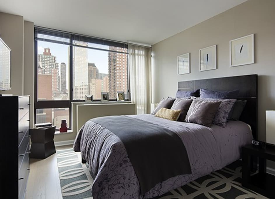 You have a comfy queen bed, spacious closet, a desk and chair for any work you may need to get done.