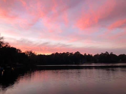 Enjoy beautiful sunsets at 2BR lake house.