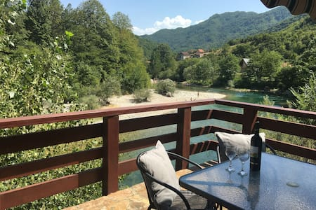 Cozy house next to the river Neretva in nature