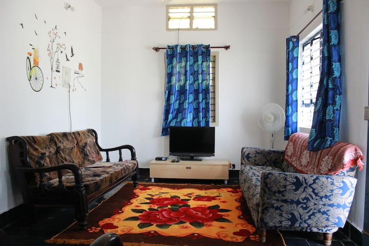 Living room with good sun light. Equipped with LED TV (Tata Sky)