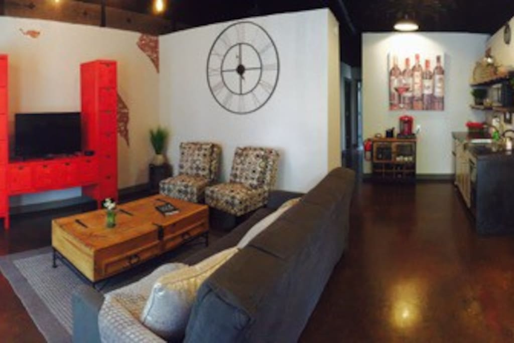 Panoramic view of the living room, kitchen and work space