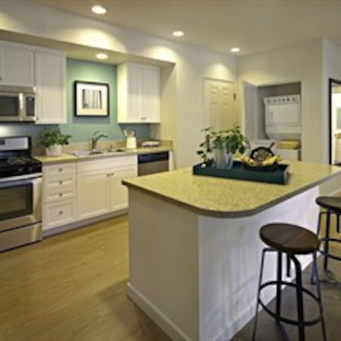 Similar floor plan to our specific unit! Large center island and hard wood floors