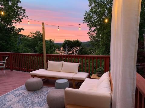 Lakeside 4BR chalet: deck, fireplace, & lake views
