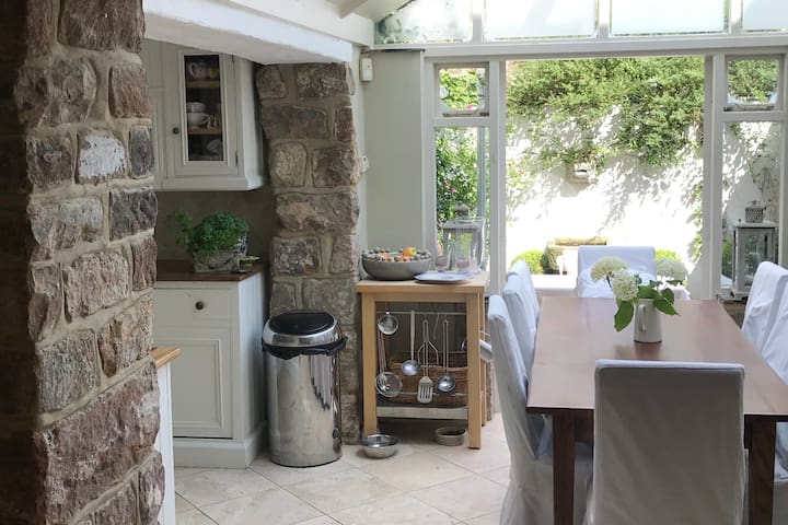 The ground floor sitting room and kitchen with dining for up to 8 people.  Open plan leading onto a private courtyard with fountain.