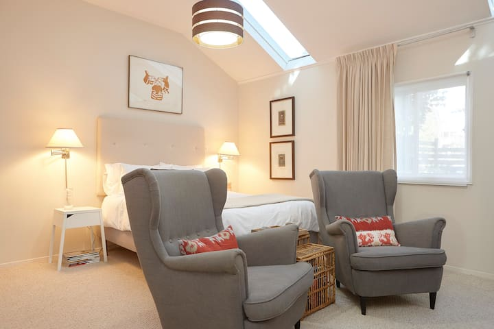 Sunny suite, two skylights, vaulted ceiling.