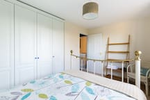 Bedroom 2 (13' x 8') - additional bedding in wardrobe and convenient shelving. Room for further mattress (provided) if required.