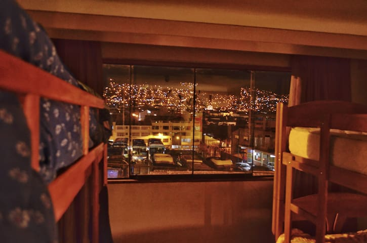Watch how the city lights up at night, from your bed!