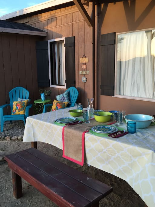 Outdoor dining table with large set of outdoor dinnerware (or breakfast-ware...)
