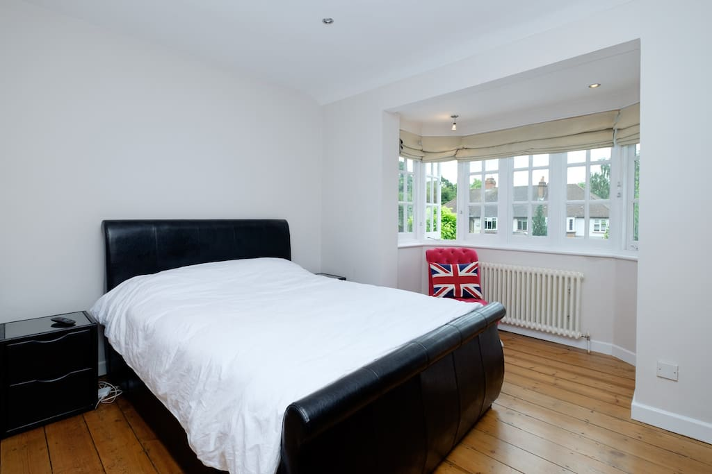 Bedroom 1: A spacious room with a king size bed and TV