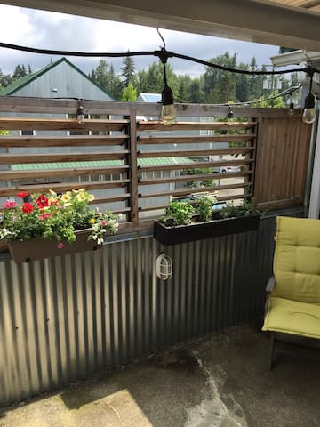 Small deck for your sitting enjoyment. Help yourself to the growing herbs while creating a meal.
