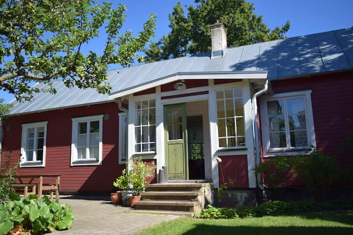 Gardener's charming century-old house.