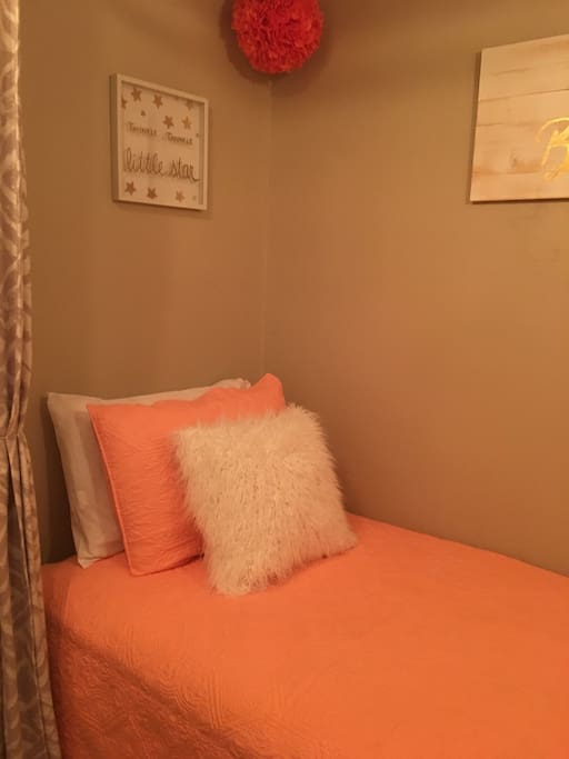 Our Nook area. Twin bed with privacy curtains.