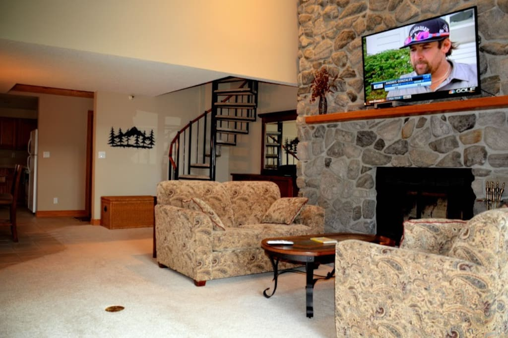 Fireplace and TV.