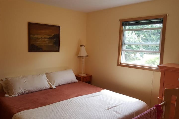 Cottage bedroom with king bed