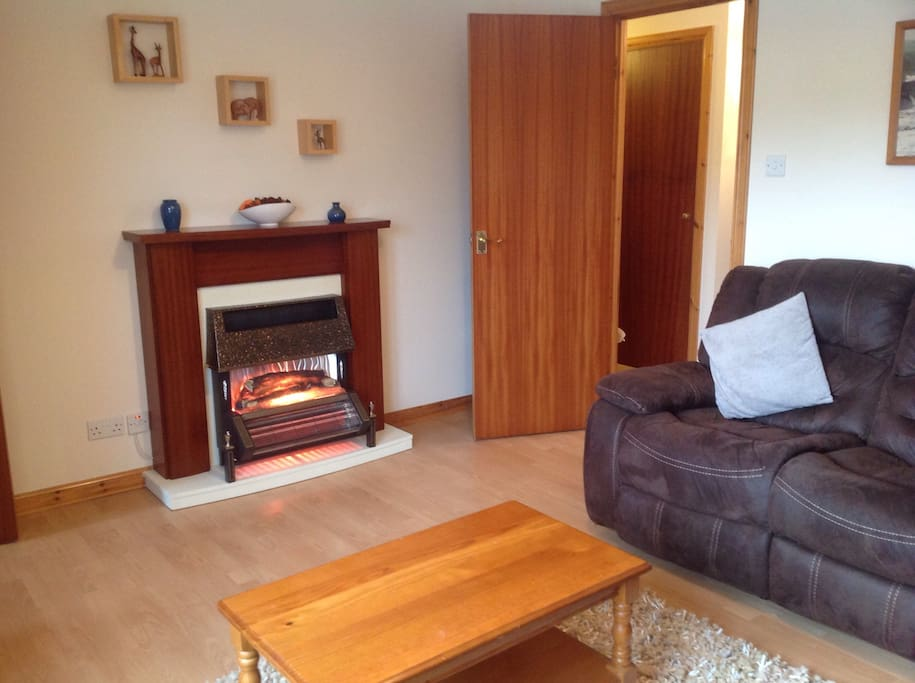 Lovely comfortable lounge with warm fireplace and large corner sofa. TV with freeview channels for you to enjoy