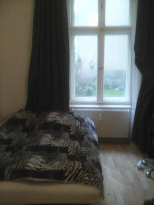 This is your room with the garden view. It is small, but should suffice for sleeping and checking the internet