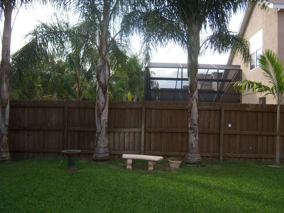 view of the backyard that is surrounded by a 8 foot gate