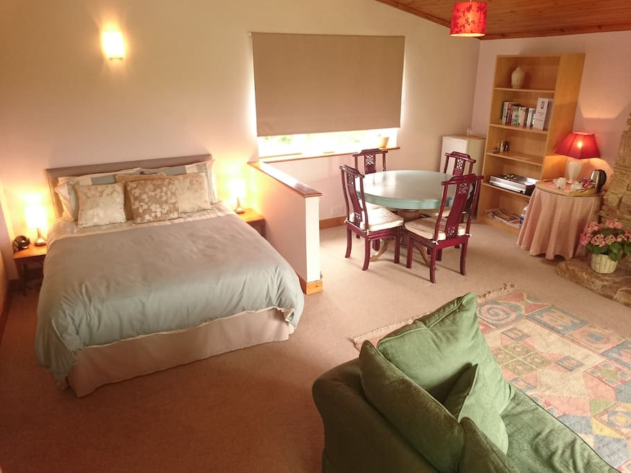 King size bed, dining and sitting areas