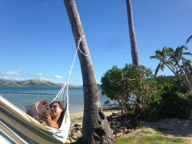 Relax reading your book in one of 5 hammocks on the beach!