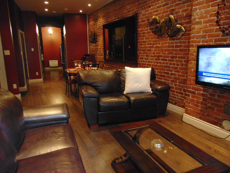 Spacious Apartment with Exposed Interior Brick Walls.